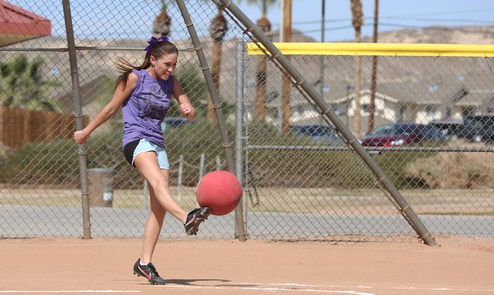 Jessica Kick, in-fielder, the Crash, kicks the ball during a spouses' kickball game at Felix Field, March 15, 2015. The league currently has more than 70 spouses participating who are divided into five teams. (Official Marine Corps photo by Pfc. Levi Schultz/Released)