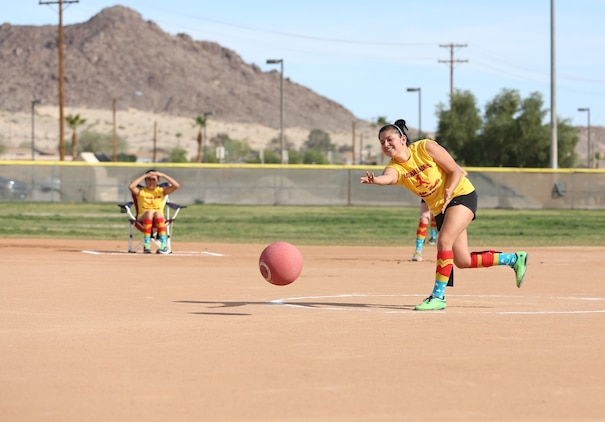 Ashley Mariano, pitcher, the First Ladies, pitches the ball during a spouses' kickball game at Felix Field, March 15, 2015. The participating teams include the Lady Coyotes, the Lady Spartans, The Crash, the First Ladies and the Grass Stains. (Official Marine Corps photo by Pfc. Levi Schultz/Released)