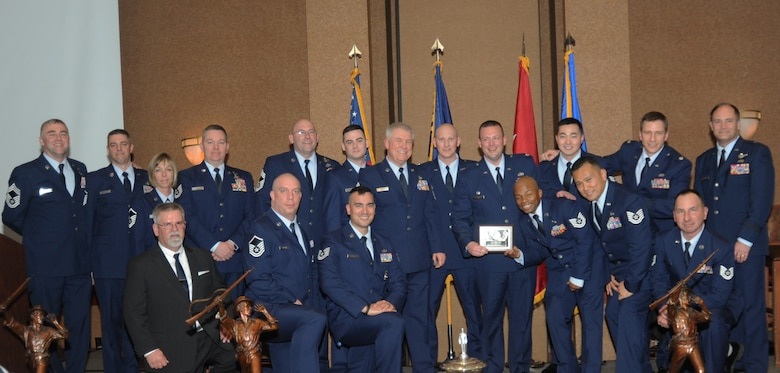 Members of the 142nd Civil Engineer Squadron, 142nd Fighter Wing, gather for a group photograph with Air Component Commander Brig. Gen. Michael Stencel, far right, during the 21st Annual Oregon Air National Guard Awards Banquet, March 14, 2015, Portland, Ore. The 142nd CES was awarded the Oregon Air National Guard's Outstanding Unit of the Year Award for 2014.