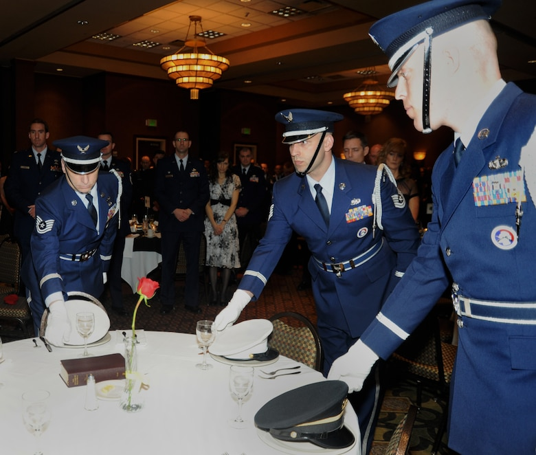 Members of the 142nd Fighter Wing Base Honor Guard, Portland Air National Guard Base, Ore., perform a MIA-POW Hat Ceremony during the 21st Annual Oregon Air National Guard Awards Banquet, March 14, 2015, Portland. (U.S. Air National Guard photo by Tech. Sgt. Emily Thompson, 142nd Fighter Wing Public Affairs/Released)