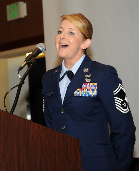 Oregon Air National Guard Senior Master Sgt. Denise Phillips, assigned to the 142nd Fighter Wing Mission Support Group, performs the National Anthem to begin the 21st Annual Oregon Air National Guard Awards Banquet, March 14, 2015, Portland, Ore. (U.S. Air National Guard photo by Tech. Sgt. Emily Thompson, 142nd Fighter Wing Public Affairs/Released)