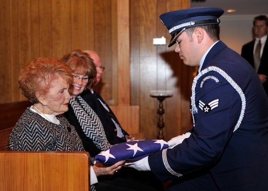 """A Tyndall Honor Guard member presents the U.S. flag to the family of U.S. Air Force Col. (Ret.) Robert """"Don"""" Gregor March 1 at the Wilson Funeral Home Chapel in Panama City, Fla. during his funeral. Gregor was the Tyndall base commander and the vice commander of the Weapons Center at one point in his career. (U.S. Air Force photo by Airman 1st Class Sergio A. Gamboa/Released)"""