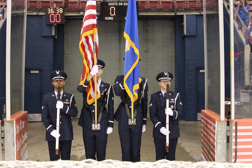 """The Joint Base Charleston Honor Guard present the colors during the national anthem at the South Carolina Stingrays military appreciation night at the North Charleston Coliseum March 14, 2015. The team's players wore special """"Stars and Stripes"""" jerseys'  that were later auctioned off. The Stingrays beat the Gwinnett Gladiators 6-0 for their ECHL record of 18 consecutive games. (Courtesy photo / South Carolina Stingrays)"""