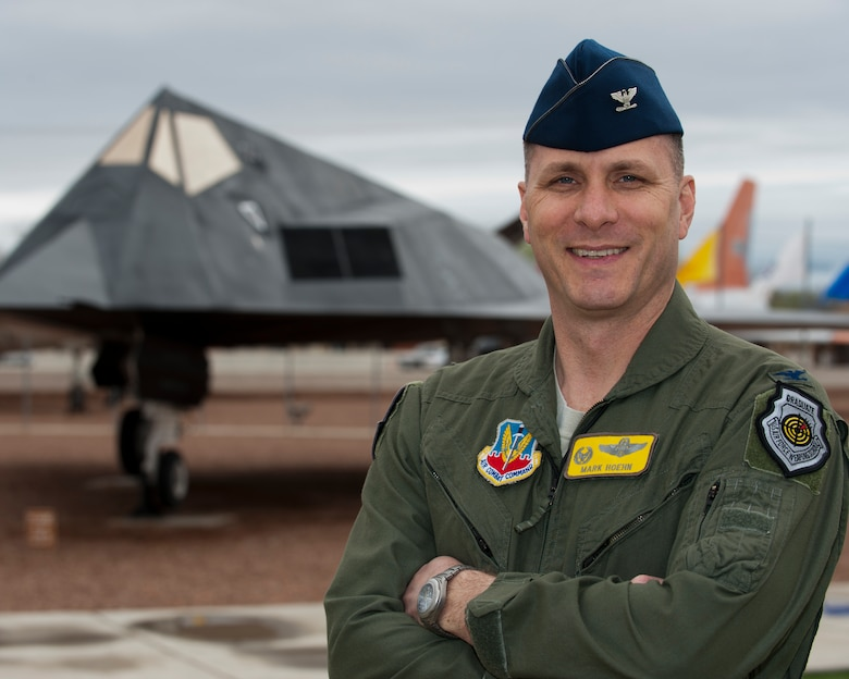 Col. Mark Hoehn, 49th Operations Group commander, poses in front of an F-117 Nighthawk stealth fighter static display March 18 at Heritage Park, Holloman Air Force Base, N.M. On March 19, 2003, Hoehn and then Lt. Col. David Toomey, both deployed from the 49th Fighter Wing, launched airstrikes over Baghdad, marking the beginning of Operation Iraqi Freedom. Twelve years later, Hoehn is back at Holloman passing his skills along to MQ-1 Predator and MQ-9 Reaper pilots. (U.S. Air Force photo by Airman 1st Class Emily A. Kenney/Released)