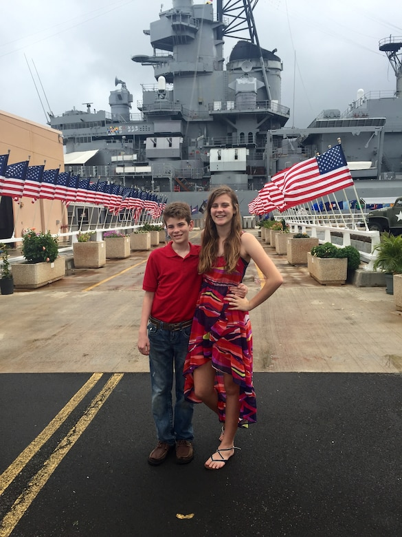 Sydnie and Lance Rouleau, children of U.S. Air Force Lt. Col. Nelson Rouleau, stand in front of the U.S.S. Missouri, Ford Island, Hawaii. Sydnie and Lance created the Rouleau Foundation to offer financial support to members of their military community. (Courtesy photo)