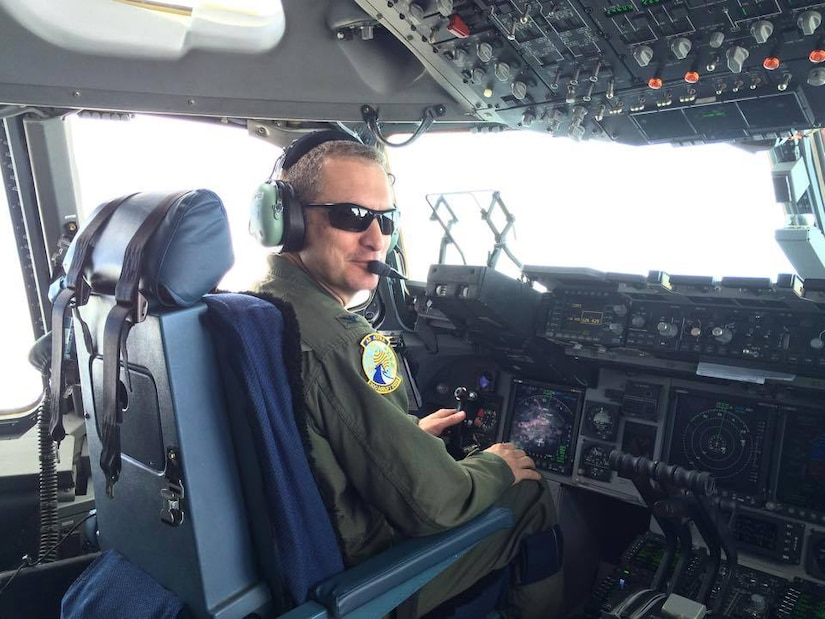 Colonel James Fontanella, 315th Airlift Wing commander is at the controls of a C-17 Globemaster III during his fini flight March 13, 2015 at Joint Base Charleston, S.C. Fontanella will be leaving the 315th AW to become the commander of the Force Generation Center at Robins Air Force Base, Ga. His change of command his currently scheduled for April 11, 2015. (Courtesy photo / Maj. Suzie Gordon)