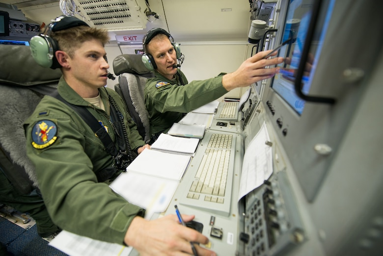 U.S. Air Force aircrew members with the 116th Air Control Wing, Georgia Air National Guard, monitor surveillance information during a mission aboard an E-8C Joint STARS (JSTARS), Robins Air Force Base, Ga., Nov. 15, 2014. The JSTARS platform provides wide-area, all-weather, surface surveillance radar that is used in a combat capacity supporting combatant commanders across the globe. They can also provide valuable data during domestic natural disasters; such as hurricanes and tornadoes, by communicating real-time geographic data to ground personnel to help safely evacuate citizens. (U.S. Air National Guard photo by Tech. Sgt. Regina Young/Released)(Portions of the photo have been blurred and names withheld for security purposes)