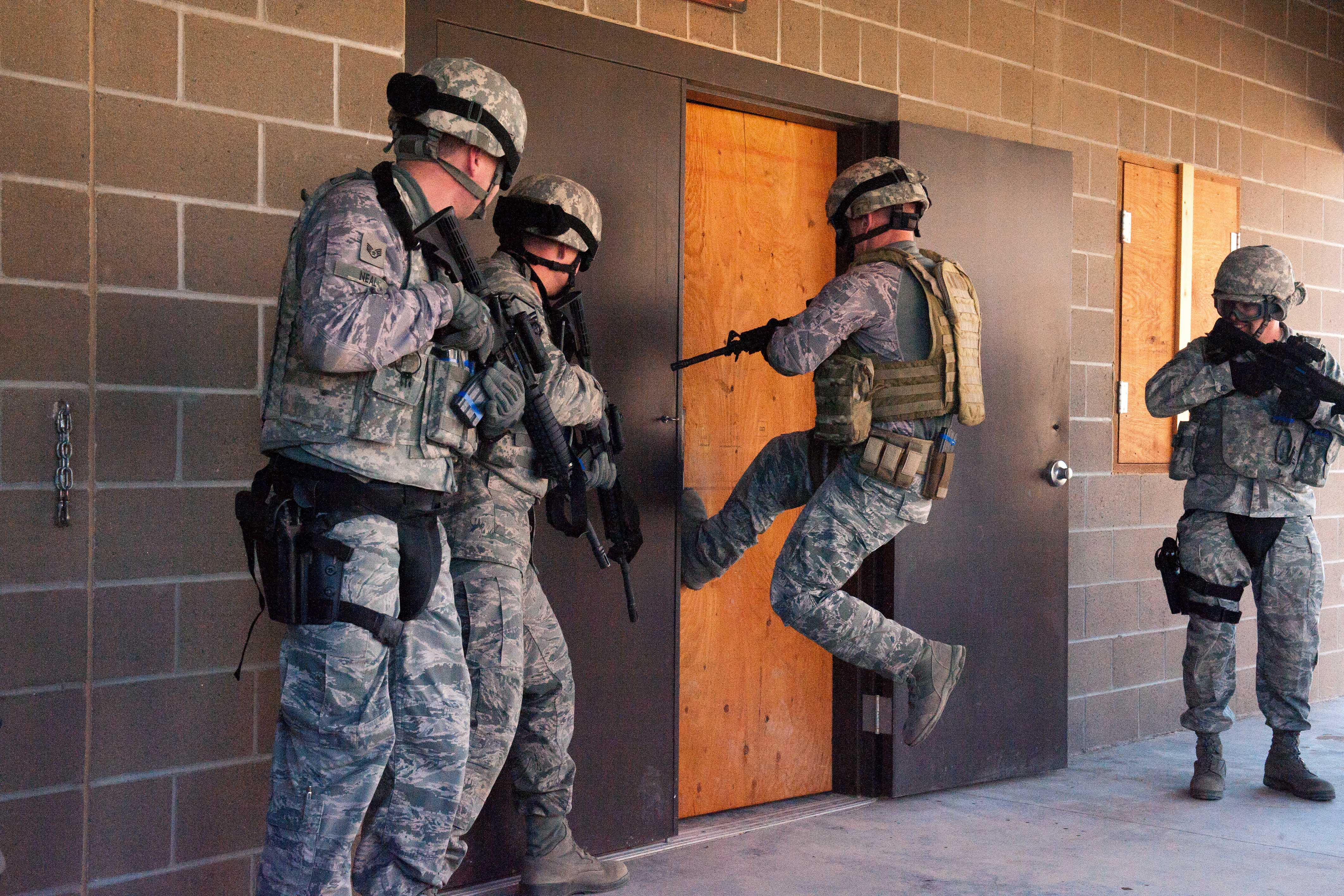 An airman attempts a jumping kick to breach a door during a shoot move and & U.S. DEPARTMENT OF DEFENSE \u003e Photos \u003e Photo Gallery