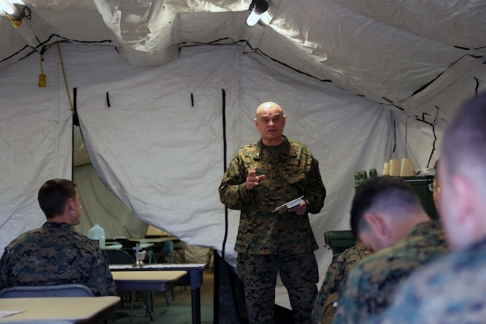 Navy Capt. Bill Appleton, the command chaplain for Headquarters Regiment, 1st Marine Logistics Group, gives a sermon to Marines and Sailors during the I Marine Expeditionary Force Exercise aboard Camp Pendleton, Calif., Feb. 22, 2015. Appleton provided Marines and Sailors with a service during the training operation for spiritual support. (Marine Corps photo by Sgt. Cody Haas/Released)