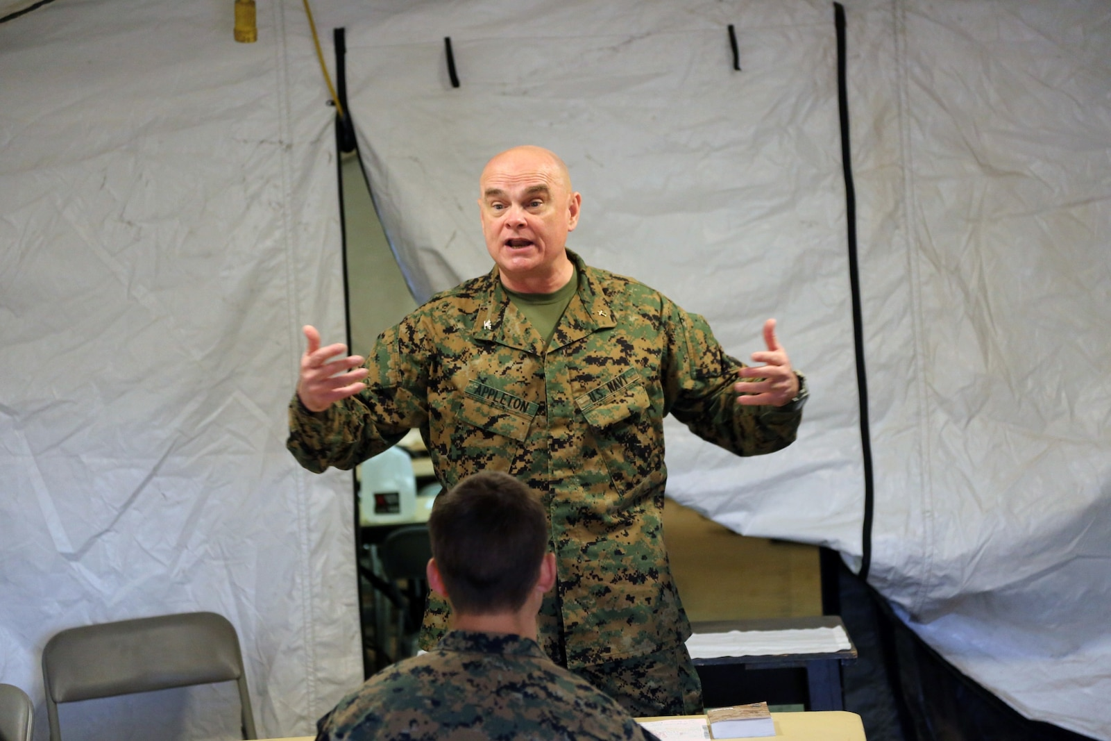 Navy Capt. Bill Appleton, the command chaplain for Headquarters Regiment, 1st Marine Logistics Group, speaks during a sermon to Marines and Sailors during the I Marine Expeditionary Force Exercise aboard Camp Pendleton, Calif., Feb. 22, 2015. Appleton provided Marines and Sailors with a service during the training operation for spiritual support. (Marine Corps photo by Sgt. Cody Haas/ Released)