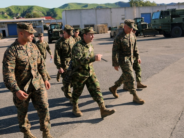 Lieutenant Col. Andres Perdomo, center, the Chief of Logistics for the Colombian Marine Corps, expresses his gratitude during a three-day tour around Combat Logistics Regiment 15, 1st Marine Logistics Group, aboard Camp Pendleton, California, March 3, 2015. Perdomo and Lt. Col. Ferdando Fernandez, a Battalion Commander for the Support Command, 6th Infantry Brigade, Colombian Marine Corps, visited 1st MLG to allow members of both the U.S. Marine Corps and Colombian Armed Forces to build an understanding of services, share best practices and strengthen camaraderie and interoperability. (U.S. Marine Corps photo by Sgt. Cody Haas/Released)
