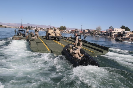 Marines with Bridge Company, 7th Engineer Support Battalion, 1st Marine Logistics Group, drive a Combat Rubber Raiding Craft onto the back of an Improved Ribbon Bridge during a training exercise on the Colorado River in Laughlin, Nev., March 17-21, 2014.  More than 60 Marines trained in moving heavy equipment, to include 7-tons and Humvees, across a flowing body of water using BEBs and an Improved Ribbon Bridge. The IRB is a multi-piece floating bridge that can function as a raft. The BEBs were used to push the raft against the current. Despite being accustomed to training in a bay with little to no current, these Marines managed to transport two 7-tons up the river at the same time.