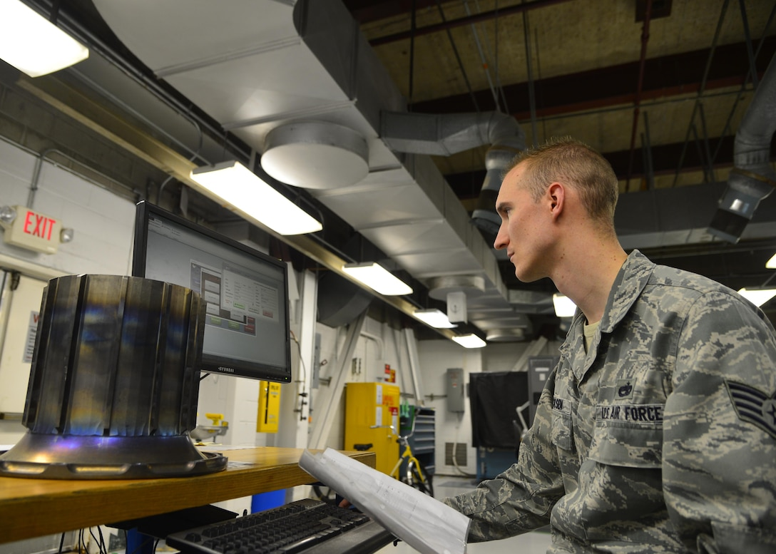 Staff Sgt. Chad Ericksen inputs data about a torque tube into the Parts, Inspection, Turnover (PIT) log March 12, 2015, at Dover Air Force Base, Del. Ericksen created the PIT program in 2012 to transition from log books to a more modern format with better report accuracy. Ericksen is a non-destructive inspection craftsman assigned to the 436th Maintenance Squadron. (U.S. Air Force photo/Airman 1st Class William Johnson)