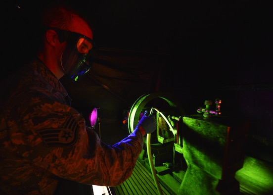 Staff Sgt. Chad Ericksen conducts particle testing on a crane hook March 13, 2014, at Dover Air Force Base, Del. Ericksen reports the findings of his test into the Parts, Inspection, Turnover (PIT) log that he created in 2012 as a way to better record maintenance records within NDI. Ericksen is a non-destructive inspection craftsman assigned to the 436th Maintenance Squadron. (U.S. Air Force photo/Airman 1st Class William Johnson)
