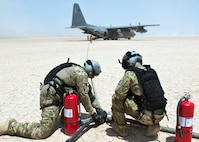 Members from the 81st Expeditionary Rescue Squadron prepare fuel hoses from an HC-130 Combat King as part of a forward arming and refuel point exercise Mar 12, 2015, at Grand Bara, Djibouti. Providing a FARP allowed several smaller airframes to refuel with engines still running, enabling the aircraft to fly missions almost non-stop. (U.S. Air Force photo/Staff Sgt. Kevin Iinuma)