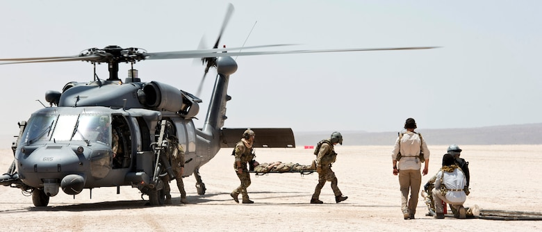 Airmen from the 303rd Expeditionary Rescue Squadron conduct a casualty evacuation exercise in conjunction with a refueling exercise with the 81st Expeditionary Rescue Squadron Mar 12, 2015, at Grand Bara, Djibouti .  The 81st ERQS provided a forward arming and refueling point allowing the 303rd ERQS to refuel the HH-60 Pave Hawk with engines still running, enabling them to fly missions almost non-stop. (U.S. Air Force photo/Staff Sgt. Kevin Iinuma)