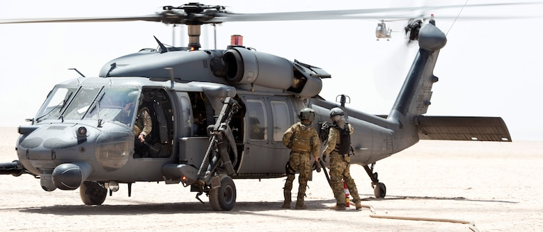 Members from the 81st Expeditionary Rescue Squadron and 303rd Expeditionary Rescue Squadron refuel an HH-60 Pave Hawk during a forward arming and refueling exercise in Grand Bara, Djibouti on Mar 12, 2015. Providing a FARP assisted the Pave Hawk to refuel with engines still running, enabling them to fly missions almost non-stop. (U.S. Air Force photo by Staff Sgt. Kevin Iinuma)