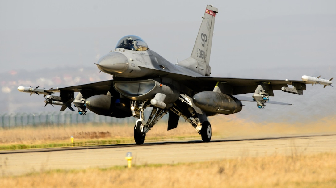 An F-16 Fighting Falcon pilot takes-off March 16, 2015, during the first sortie of Dacian Warhawk at Campia Turzii, Romania. The training missions are designed to incorporate both air and ground operations between the two nations, and include several partnership building events. The pilot is assigned to the 480th Fighter Squadron.  (U.S. Air Force photo/Staff Sgt. Armando A. Schwier-Morales)
