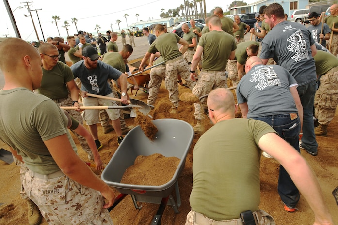 California Pizza Kitchen sent more than 700 Volunteers to assist School of Infantry – West Marines and Sailors to clean and renovate areas of San Onofre Beach, March 18. The groups broke up into three teams with one group painting and renovating the beach club, another handling landscaping and the third group painting the theatre and building playground equipment.