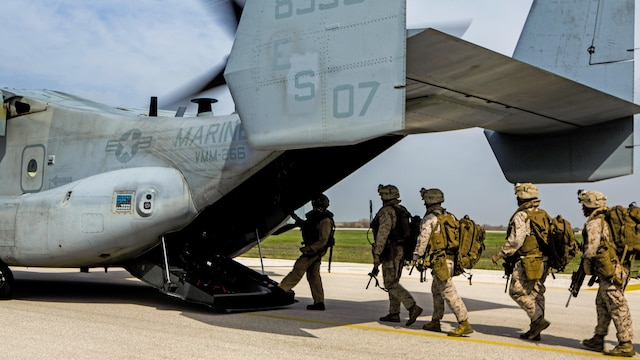 U.S. Marines with Special-Purpose Marine Air-Ground Task Force Crisis Response-Africa board an MV-22 Osprey during an alert force drill on Moron Air Base, Spain, March 13, 2015. The alert force tested its capabilities by simulating the procedures of reacting to a real-time crisis response mission by flying to Sigonella, Italy on a moment's notice.