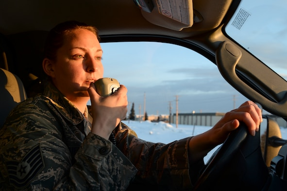 U.S. Air Force Tech. Sgt. Amanda Mueller, a 354th Medical Operations Squadron paramedic, makes a radio call at the 354th Medical Group, March 17, 2015, Eielson Air Force Base, Alaska. Mueller practiced job routines encountered when responding to emergency calls. (U.S. Air Force photo by Senior Airman Peter Reft/Released)