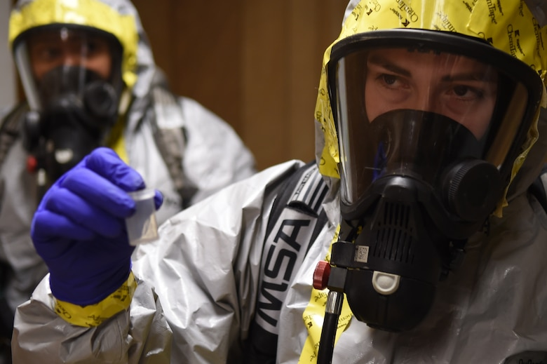 Airman Marlene Zeledon (right), samples a chemical agent during a training exercise with Staff Sgt. Yaoska Quintana (left), in the Memorial Tunnel at the Center for National Response in Gallagher, WV., March 17, 2015. This training is part of the annual Black Flag exercise for first responders. Zeledon is an 11th Civil Engineer Squadron emergency management journeyman and Quintana is the 779th Aerospace Medical Squadron NCO in-charge of flight readiness, Joint Base Andrews, Md. (U.S. Air Force photo/Airman 1st Class Joshua R. M. Dewberry)