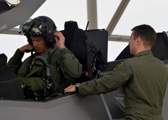 Brig. Gen. Scott Pleus, 56th Fighter Wing commander, places on the helmet during his first F-35 sortie flight at Luke Air Force Base, Ariz., March 18, 2015.  (U.S. Air Force photo/Senior Airman Devante Williams)