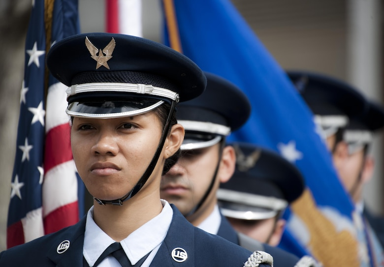 Senior Airman Hope Poialii leads the flag detail at an honor guard graduation ceremony March 4, 2015, at Eglin Air Force Base, Fla. Approximately 12 new Airmen graduated from the course. The graduation performance included a flag detail, rifle volley, pall bearers and bugler for friends, family and unit commanders. Poialii is assigned to the 96th Medical Services Squadron. (U.S. Air Force photo/Samuel King Jr.)
