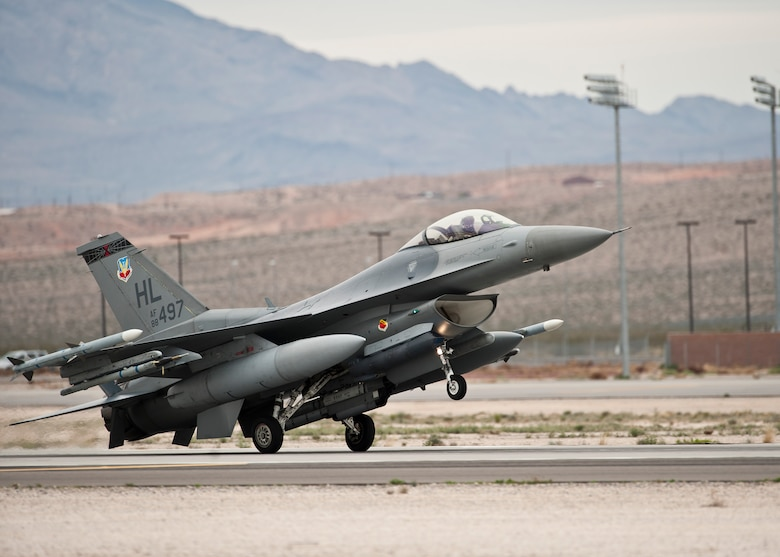 An F-16 Fighting Falcon lands after a Red Flag 15-2 sortie March 11, 2015, at Nellis Air Force Base, Nev. Red Flag provides a series of intense air-to-air scenarios for aircrew and ground personnel to increase their combat readiness and effectiveness for future real-world operations. The F-16 is assigned to the 421st Fighter Squadron at Hill AFB, Utah. (U.S. Air Force photo/Staff Sgt. Siuta B. Ika)