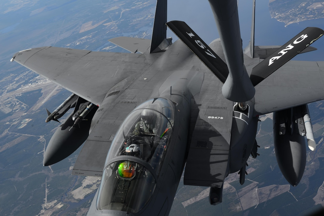 Pilots in an F-15E Strike Eagle receive fuel from a New Hampshire Air National Guard KC-135R Stratotanker March 17, 2015, over North Carolina. The pilots and F-15E are from Seymour Johnson Air Force Base, N.C. (U.S. Air National Guard photo/Airman Ashlyn J. Correia)