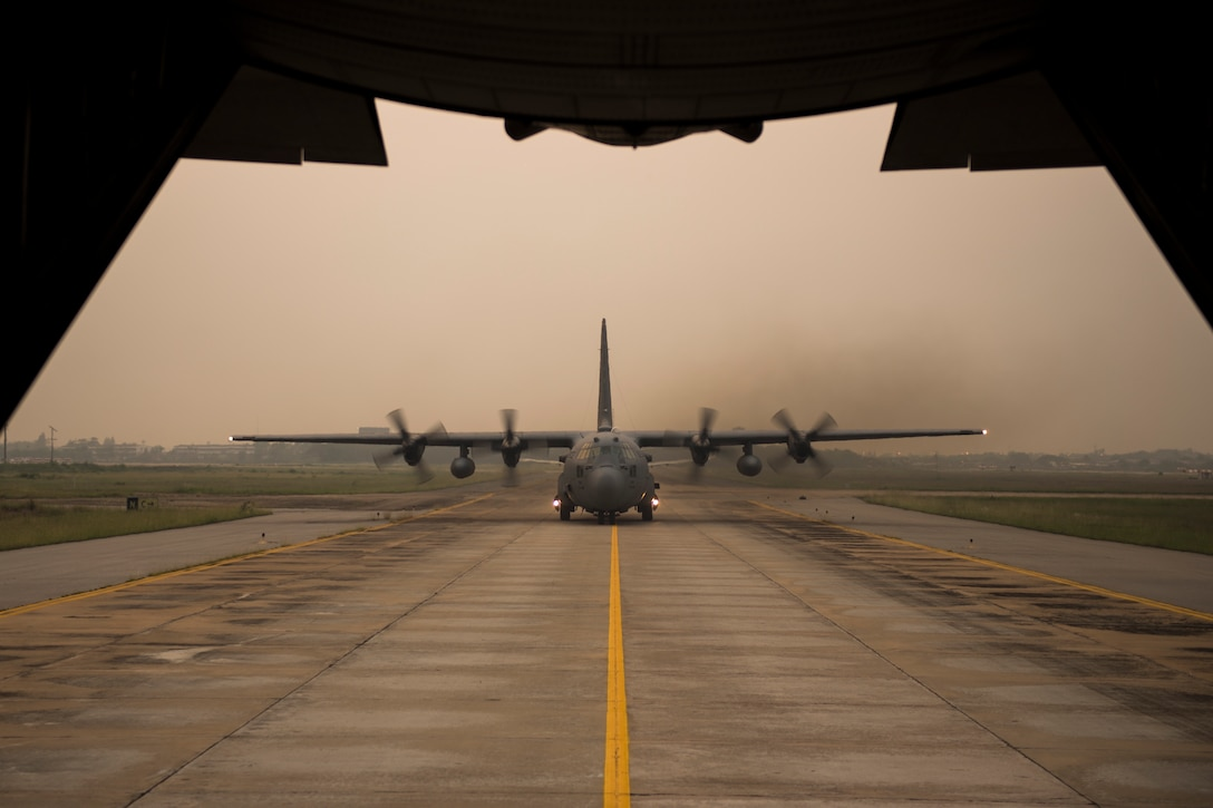 A C-130 Hercules taxis after a formation flight during exercise Cope Tiger 15 March 17, 2015, in Udonthani, Thailand. CT15 included 22 total flying units and over 1390 personnel from three countries and continues the growth of strong, interoperable, and beneficial relationships within the Asia-Pacific region. The exericse focused on integration of airborne and land-based command and control assets. (U.S. Air Force photo/Airman 1st Class Taylor Queen)