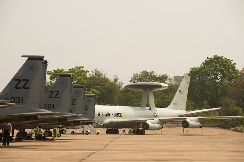 Multiple U.S. Air Force F-15 Eagles and an E-3 Sentry (AWACS) participate in exercise Cope Tiger 15 March 17, 2015, in Korat, Thailand. CT15 included 22 total flying units and over 1390 personnel from three countries and continues the growth of strong, interoperable, and beneficial relationships within the Asia-Pacific region. The exericse focused on integration of airborne and land-based command and control assets.(U.S. Air Force photo/Airman 1st Class Taylor Queen)