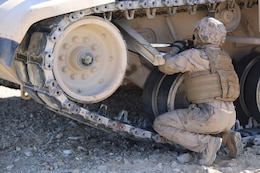 Sgt. Michelle A. Svec, driver, Tank Platoon, Company B, Ground Combat Element Integrated Task Force, breaks track on an M1A1 Abrams tank during a Marine Corps Operational Test and Evaluation Activity assessment at Range 500, Marine Corps Air Ground Combat Center Twentynine Palms, California, March 7, 2015. From October 2014 to July 2015, the GCEITF will conduct individual and collective level skills training in designated ground combat arms occupational specialties in order to facilitate the standards-based assessment of the physical performance of Marines in a simulated operating environment performing specific ground combat arms tasks. (U.S. Marine Corps photo by Cpl. Paul S. Martinez/Released)
