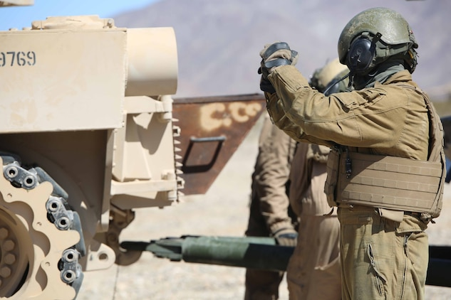 Sgt. Gilbert Ibarra, gunner, Tank Platoon, Company B, Ground Combat Element Integrated Task Force, directs the towing of an M1A1 Abrams tank during a Marine Corps Operational Test and Evaluation Activity assessment at Range 500, Marine Corps Air Ground Combat Center Twentynine Palms, California, March 7, 2015. From October 2014 to July 2015, the GCEITF will conduct individual and collective level skills training in designated ground combat arms occupational specialties in order to facilitate the standards-based assessment of the physical performance of Marines in a simulated operating environment performing specific ground combat arms tasks. (U.S. Marine Corps photo by Cpl. Paul S. Martinez/Released)