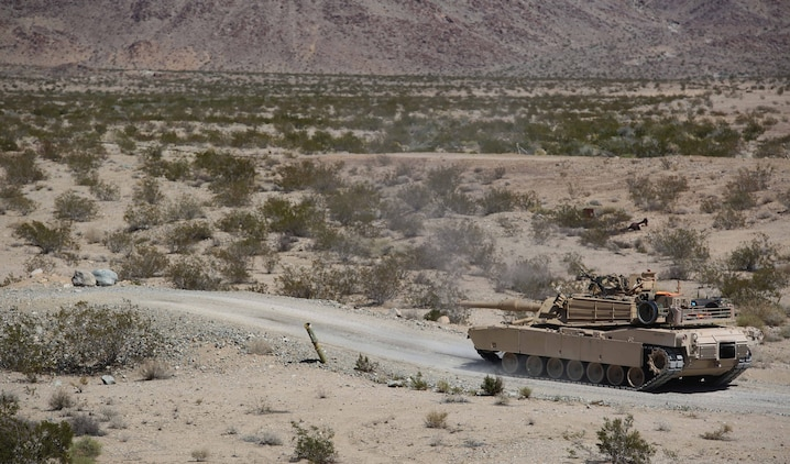 Marines with Tank Platoon, Company B, Ground Combat Element Integrated Task Force, assault targets down range using their .50 caliber machine during a Marine Corps Operational Test and Evaluation Activity assessment at Range 500, Marine Corps Air Ground Combat Center Twentynine Palms, California, March 7, 2015. From October 2014 to July 2015, the GCEITF will conduct individual and collective level skills training in designated ground combat arms occupational specialties in order to facilitate the standards-based assessment of the physical performance of Marines in a simulated operating environment performing specific ground combat arms tasks. (U.S. Marine Corps photo by Cpl. Paul S. Martinez/Released)