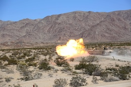 Marines with Tank Platoon, Company B, Ground Combat Element Integrated Task Force, fire their 120mm M1A1 Abrams tank main gun during a Marine Corps Operational Test and Evaluation Activity assessment at Range 500, Marine Corps Air Ground Combat Center Twentynine Palms, California, March 7, 2015. From October 2014 to July 2015, the GCEITF will conduct individual and collective level skills training in designated ground combat arms occupational specialties in order to facilitate the standards-based assessment of the physical performance of Marines in a simulated operating environment performing specific ground combat arms tasks. (U.S. Marine Corps photo by Cpl. Paul S. Martinez/Released)
