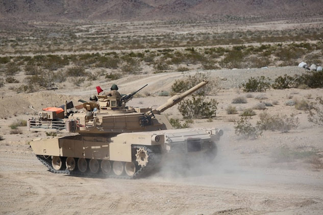 Marines with Tank Platoon, Company B, Ground Combat Element Integrated Task Force, maneuver across the firing line during a Marine Corps Operational Test and Evaluation Activity assessment at Range 500, Marine Corps Air Ground Combat Center Twentynine Palms, California, March 7, 2015. From October 2014 to July 2015, the GCEITF will conduct individual and collective level skills training in designated ground combat arms occupational specialties in order to facilitate the standards-based assessment of the physical performance of Marines in a simulated operating environment performing specific ground combat arms tasks. (U.S. Marine Corps photo by Cpl. Paul S. Martinez/Released)