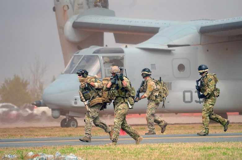 Pararescue jumpers and combat rescue officers conduct joint training with the 7th Special Forces Group March 11, 2015, in Perry, Ga. The four-day exercise used HH-60 Pave Hawks and MV-22 Ospreys for simulated scenarios that included earthquake collapsed buildings, vehicle-borne improved explosive devices detonating, and mass casualty response. The pararesue jumpers and rescue officers are from the 920th Rescue Wing at Patrick Air Force Base, Fla. (U.S. Air Force photo/Staff Sgt. Kelly Goonan)