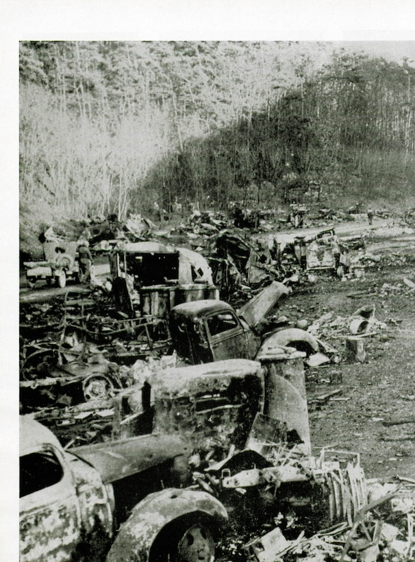 Grim results of a fighter-bomber attack on a German convoy caught on a road between Kaiserslautern and Dad Durkheim, circa March, 1945.  (The Story of the 371st Fighter Group in the E.T.O.)