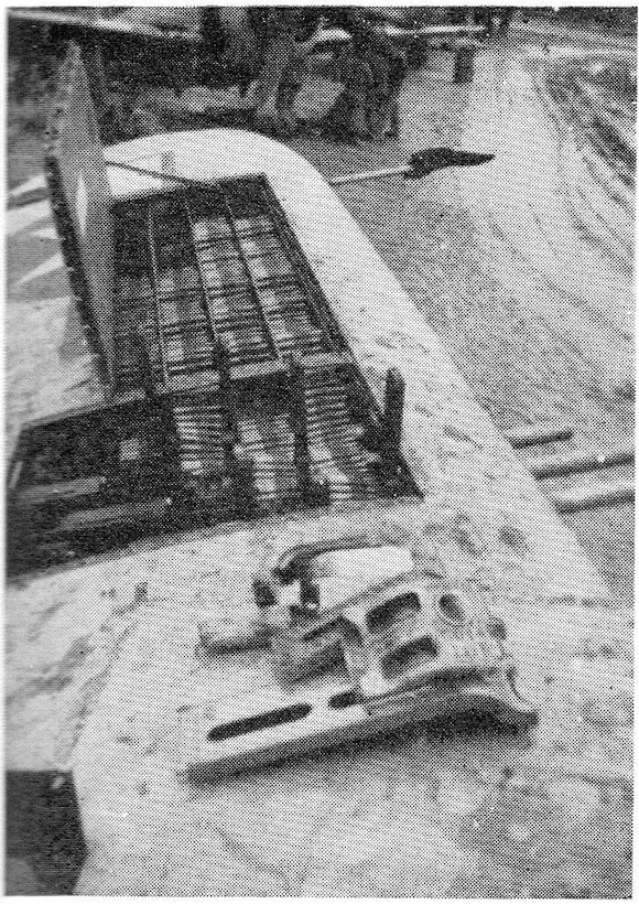 Squadron armorers have loaded the ammunition bays for this 371st Fighter Group P-47 Thunderbolt, possibly at Metz Airfield in early 1945.  The staggered position of the four machine guns in the wing allowed for the direct feed of .50 caliber machine gun ammunition from the corresponding tray.  Muddy conditions were a bother but did not prevent the servicing of the fighters to accomplish the mission.  The P-47 could carry up to 425 rounds per gun, but there was a tradeoff with the weight in performance and range, and often fewer rounds were carried, often closer to 300 rounds.  (The Story of the 371st Fighter Group in the E.T.O.)