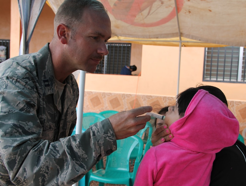 Chaplain Samuel McClellan provides medicine to a local Honduran child during a Medical Readiness Training Exercise, March 11-15, 2015. Joint Task Force-Bravo's Medical Element (MEDEL), with support from JTF-Bravo's Joint Security Forces and Army Forces Battalion, partnered with the Honduran Ministry of Health and the Honduran military to provide medical care to 5,352 people and performed 11 surgeries over three days in the Department of Copan and Lempira, Honduras during a Mobile Surgical Team (MST), Medical Readiness Training Exercise (MEDRETE), and a Medical Partnership Exercise (MPE). (Photo by U.S. Army Sgt. Stephanie Tucker)