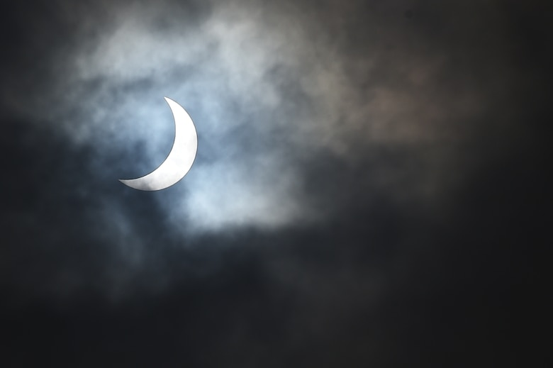 The moon moves past its position between the sun and the Earth at 9:52 a.m. during a solar eclipse, visible from RAF Alconbury, England, March 20, 2015. Due to cloud coverage, many UK residents were not able to witness the eclipse. (U.S. Air Force photo by Staff Sgt. Jarad A. Denton/Released)