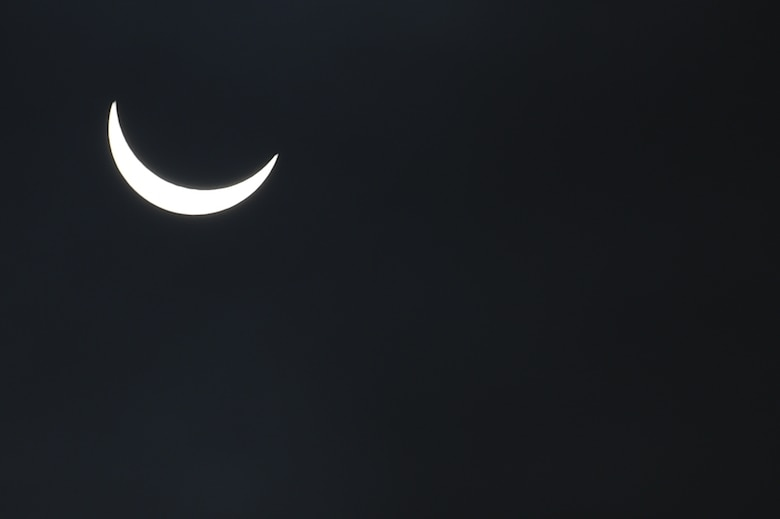 The moon continues its pass between the sun and the Earth at 9:32 a.m. during a solar eclipse, visible from RAF Alconbury, England, March 20, 2015. Throughout the United Kingdom, darkness from the eclipse peaked at approximately 9:35 a.m. (U.S. Air Force photo by Staff Sgt. Jarad A. Denton/Released)