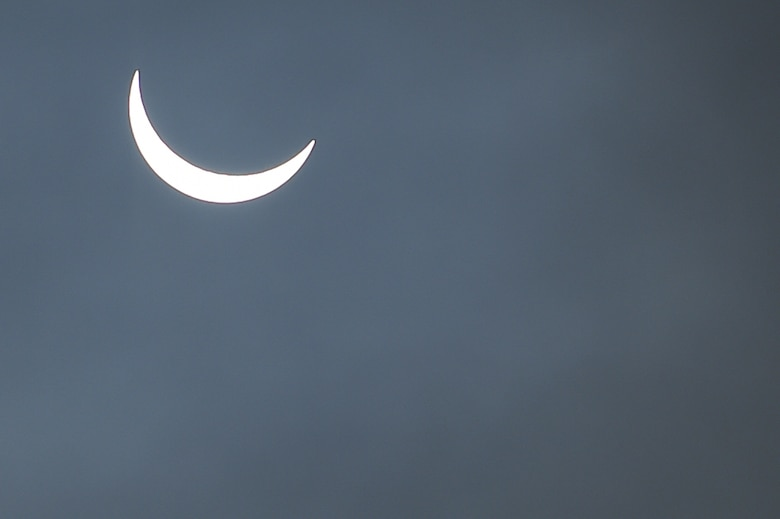 The moon continues its pass between the sun and the Earth at 9:31 a.m. during a solar eclipse, visible from RAF Alconbury, England, March 20, 2015. An 83 percent eclipse was visible throughout the entire United Kingdom. (U.S. Air Force photo by Staff Sgt. Jarad A. Denton/Released)