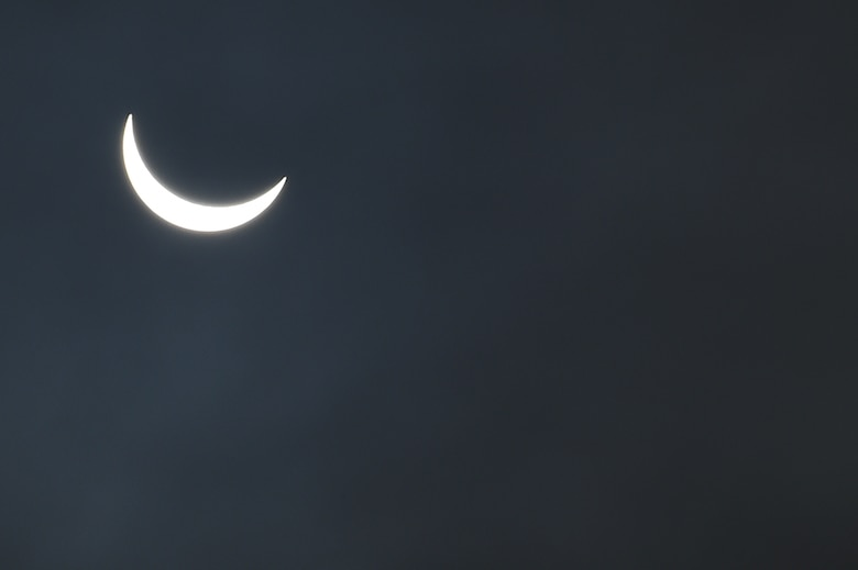 The moon continues its pass between the sun and the Earth at 9:30 a.m. during a solar eclipse, visible from RAF Alconbury, England, March 20, 2015. An 83 percent eclipse was visible throughout the entire United Kingdom. (U.S. Air Force photo by Staff Sgt. Jarad A. Denton/Released)