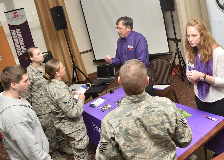 Airmen from the 107th Airlift Wing receive information from local colleges as part of a recruiting and retention education fair at the Niagara Falls Reserve Station March 21, 2015. (U.S. Air National Guard photo/Senior Master Sgt. Ray Lloyd.)