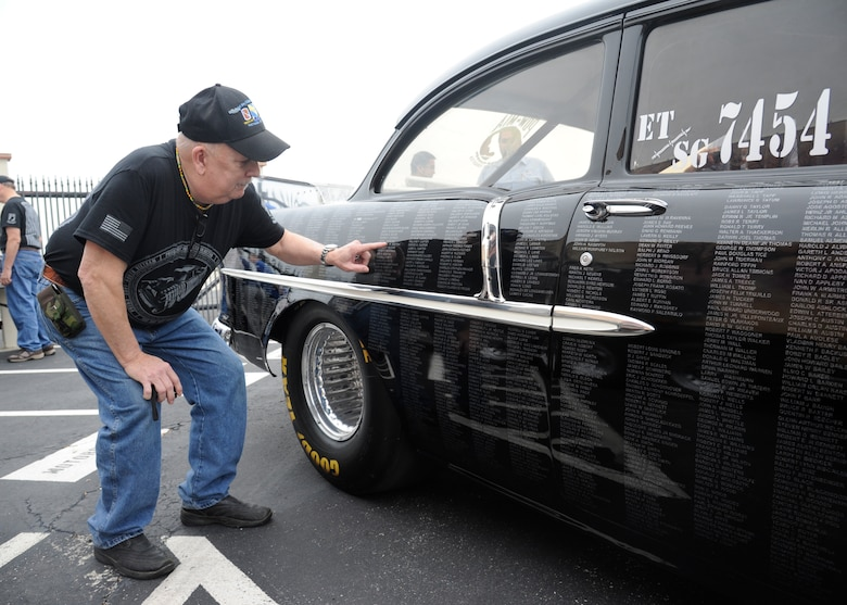 """Phillip Jones, Vietnam combat infantry soldier, takes a closer look at the names on the POW MIA vehicle during the 42nd Freedom Flyer Reunion at Joint Base San Antonio-Randolph March 20. The events honor all POWs held captive during the Vietnam War. The tradition began when members of the 560th Flying Training Squadron were given the task to retrain more than 150 POWs returning to flying status. To honor their return, their initial training included a """"freedom flight."""" The last group of POWs was released from captivity in North Vietnam March 1973. (U.S. Air Force Photo by Harold China)"""
