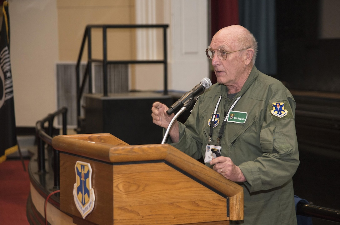 """Retired Navy Capt. Mike McGrath, former Vietnam War POW, speaks about his experiences in captivity at the 18th Annual POW/MIA Symposium, hosted by the 560th Flying Training Squadron at the Joint Base San Antonio-Randolph Fleenor Auditorium March 20. McGrath was shot down by enemy fire over North Vietnam June 30, 1967 flying an A-4C """"Skyhawk"""". He was held as a POW for almost six years until his release March 4, 1973. The annual Freedom Flyer Reunion tradition began when members of the 560th FTS were given the task to retrain more than 150 POWs returning to flying status toward the end of American involvement in the Vietnam War. (U.S. Air Force photo by Johnny Saldivar)"""