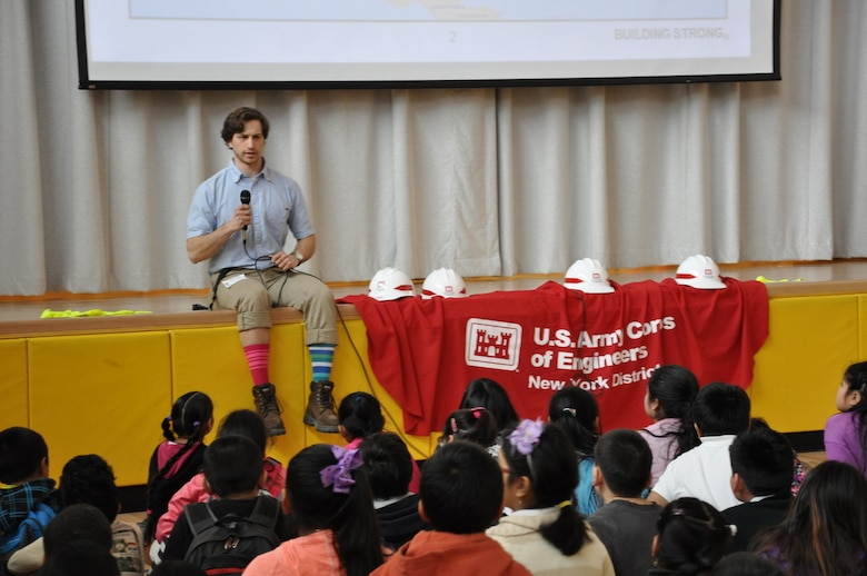 Ian Pumo, civil engineer, U.S. Army Corps of Engineers, New York District is all wacked out in multi-colored socks – in celebration of the school's Wacky Wednesday's theme – as he describes how engineers solve problems to improve our lives.