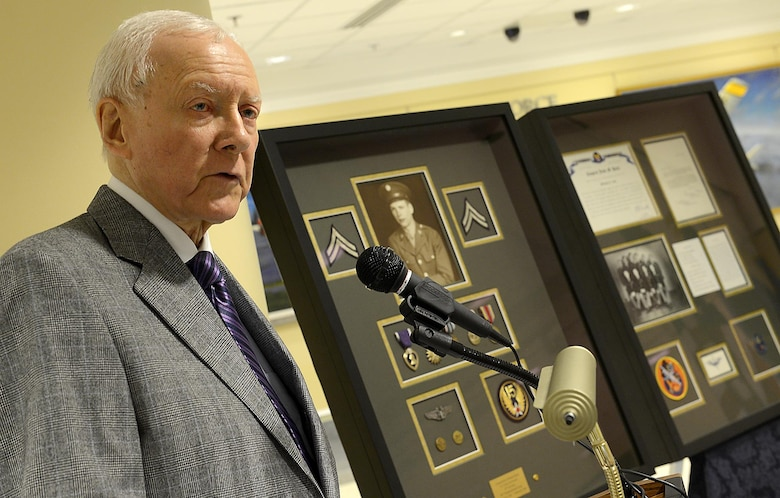 Sen. Orrin Hatch of Utah, thanks Secretary of the Air Force Deborah Lee James for presenting him with two shadow boxes March 20, 2015, at the Pentagon in Washington D.C.  The shadow boxes honored the service of his brother, Cpl. Jesse Hatch, who died with his crew during a mission in World War II. Cpl. Hatch was a nose turret gunner with the 451st Bombardment Group, 725th Bomb Squadron. (U.S. Air Force photo/Scott M. Ash)